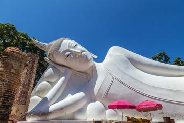 white reclining buddha statue on thai temple