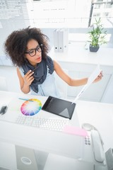 Pretty designer working at her desk