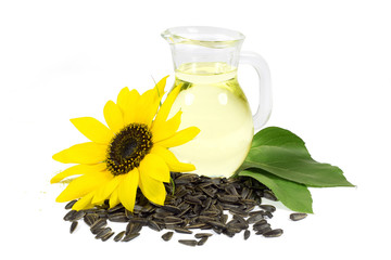 Sunflower and Seeds and Sunflower Oil in Glass Pitcher Isolated