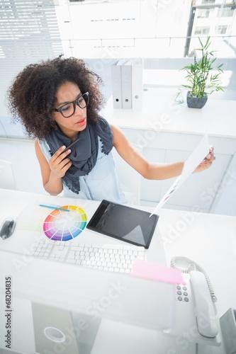 Pretty designer working at her desk