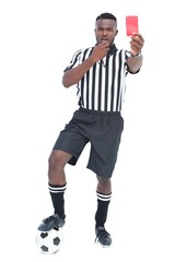 Serious referee showing red card