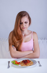 Girl on diet doesn't eat dinner