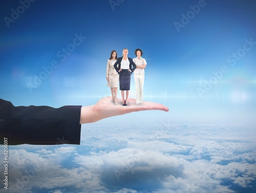 Composite image of team of businesswomen looking at camera