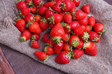 Ripe sweet strawberries on sackcloth  background