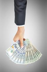 Money - hand holding United States Dollars (USD) bills