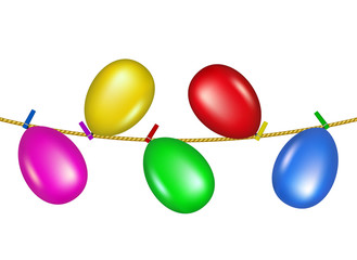 Coloured clothespins on rope holding balloons