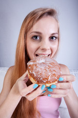 Thin girl eats donut