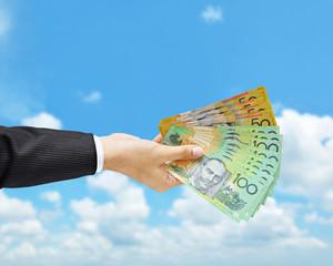 Hand holding Australian dollar (AUD) bills
