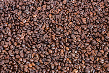 many roasted coffee beans background