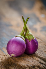 Purple eggplant on wooden floor