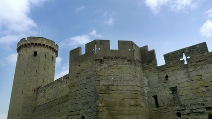 Castle walls and battlements with fast moving clouds.