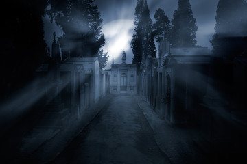 Cemetery in a foggy full moon night