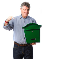 Adult man holding a postbox