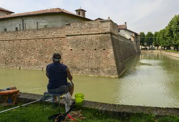 rod fishing at Visconteo Castle moat, Pagazzano