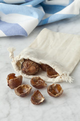 Nutshells of soapnuts in a cotton bag