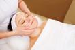 Woman taking facial treatments at beauty spa