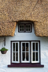irish thatched cottage windows close up