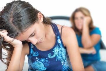 Depressed teenage girl with her worried mother