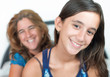 Young hispanic girl and her mother smiling