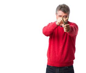 Man pointing holding a slingshot