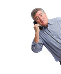 Surprised man with a telephone