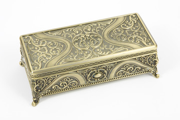 gold casket on a white background