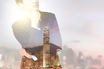 double exposure business man and city