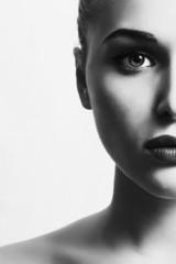 beautiful woman.close-up monochrome portrait. half face.unusual