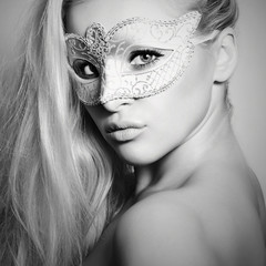 Beautiful Blond Woman in a Carnival Mask.Masquerade. Monochrome