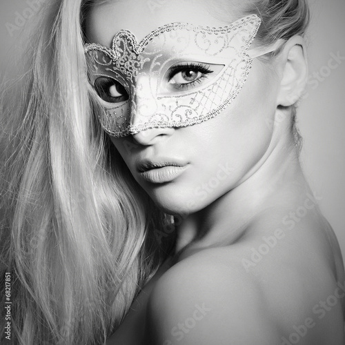 Beautiful Blond Woman in a Carnival Mask.Masquerade. Monochrome