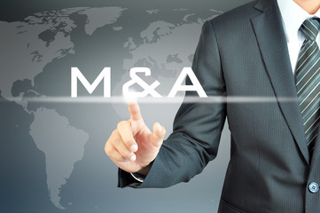 Businessman hand touching M & A or merger & acquisition