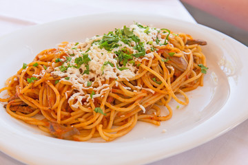 Vegetarian spaghetti with cheese on a white plate