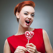 funny red-haired girl holding candy