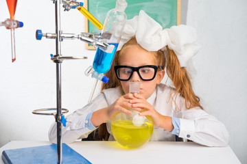Pupil at a school desk. Chemistry lesson.