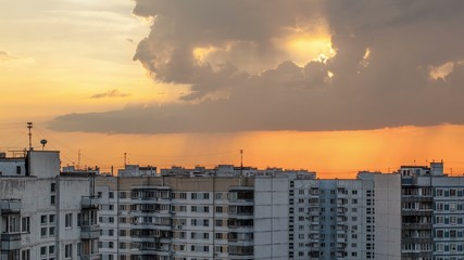 Timelapse of clouds over city during sunset