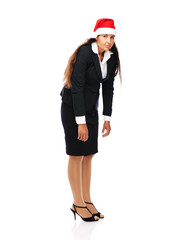 Business woman wearing santa hat is tired of christmas