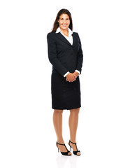 Business woman in suit smiling looking into camera