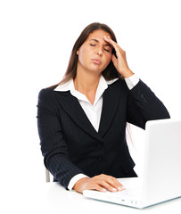 Business woman working on laptop has headache