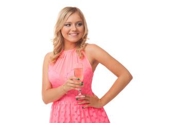 blonde woman wearing pink dress drinking champagne