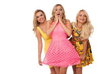 three beautiful girls in fashion dresses