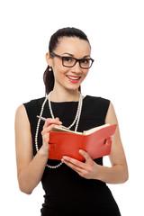 businesswomen holding orange notebook and writing