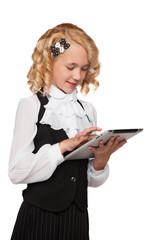 little blonde student wearing uniform holding tablet