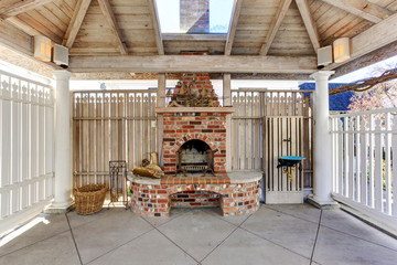 Pergola with brick fireplace on backyard