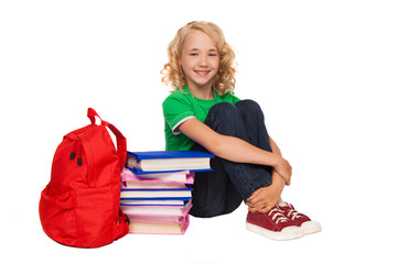 girl sitting on the floor near books and bag