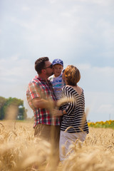 Family in wheat field.