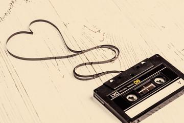 audio cassette with magnetic tape in shape of heart