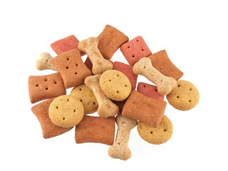 Close up of assorted shaped dog biscuits on a white background.
