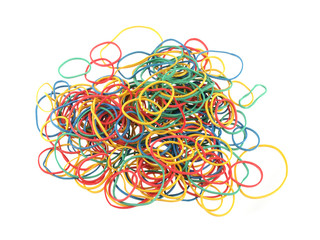 Close up of colourful rubber bands on a white background.