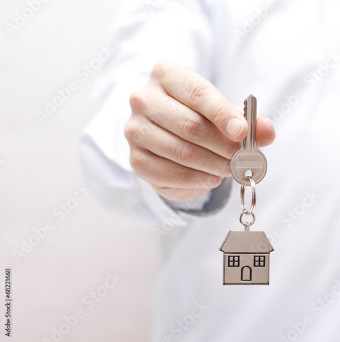 Poster House key in hand