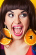 beautiful young woman wearing earrings made from orange against